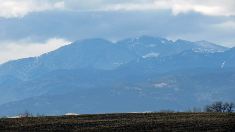 Twin Sisters Peaks with Long's Peak in the background.