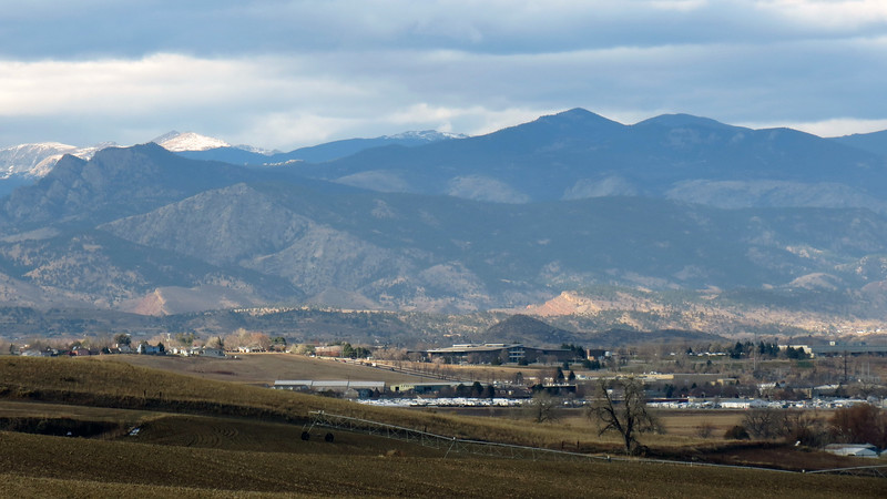 The pointed peaks on the far left foreground may be Palisade Mountain (8,264 ft), and Alexander Mountain (7,105 ft).  The snow capped peaks in the background in the center are possibly Stormy Peaks East (12,020 ft), and Stormy Peaks West (12,148 ft).  The prominent pointed peaks just right of center are possibly Storm Mountain (9,918 ft), and Lookout Mountain (10,626 ft).