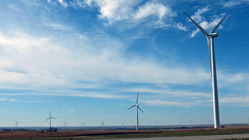 Wind turbines on both sides of I-70.