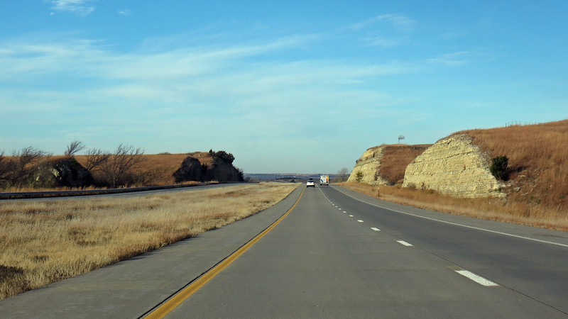 The numerous cuts through the hills for the interstate show what the ground looks like beneath the surface of those hills.