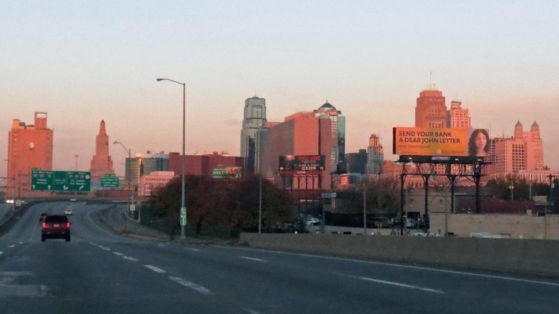 The normally east-west Interstate 70 made a northbound turn at the Power and Light District downtown which gave me a great view of the skyline.  I perched the camera on my shoulder once again and started shooting.