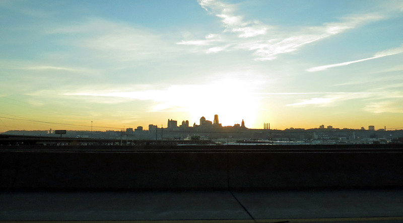 Interstate 70 crossed the Kansas River made a southbound turn which put the city skyline off to my left.  This means I was treated to sunrise over Kansas City for a brief period of time.