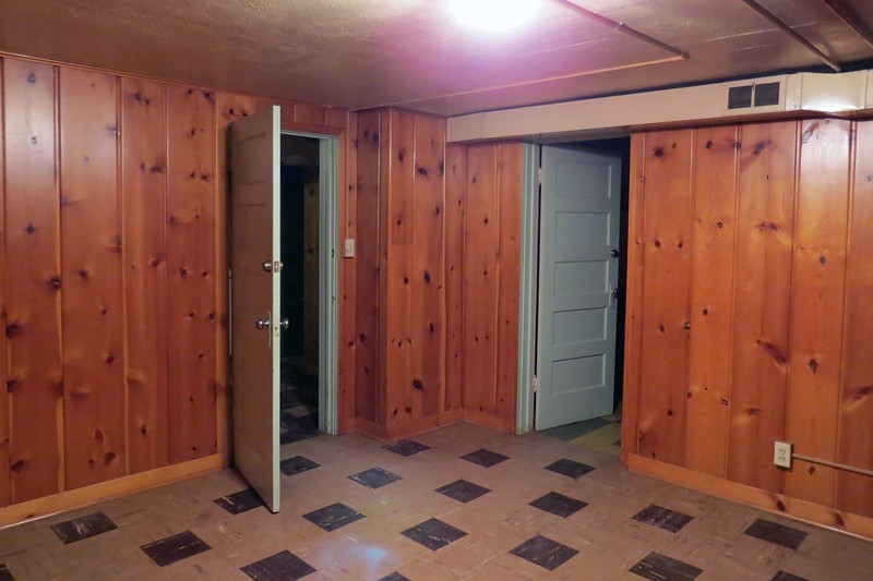 The door on the right side of the photo above leads to the basement bedroom.