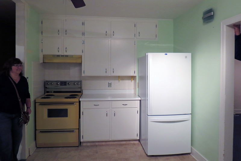 While the oven was pretty old, the refrigerator was relatively new.