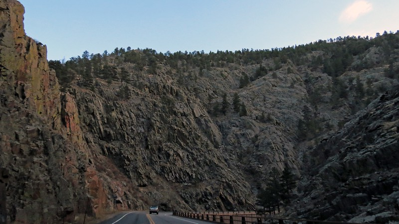 If I read the topographic map correctly, the canyon walls rise 300 – 400 feet above the roadway.