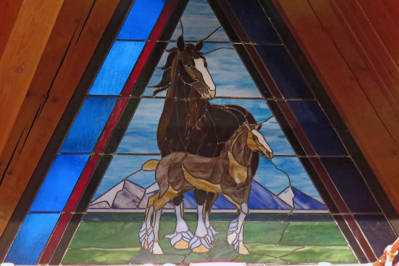 Stained glass windows in the stables.