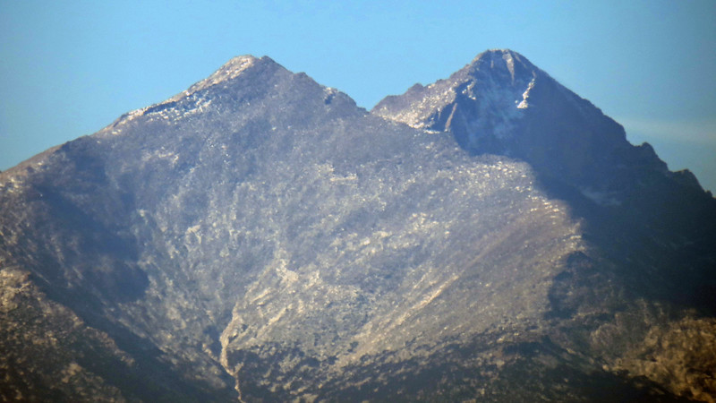The photo above is a close up of Mount Meeker and Long's Peak.  I took that photo at full zoom and lightly processed it with Photoshop Elements which brought out the details quite a bit better than I expected.