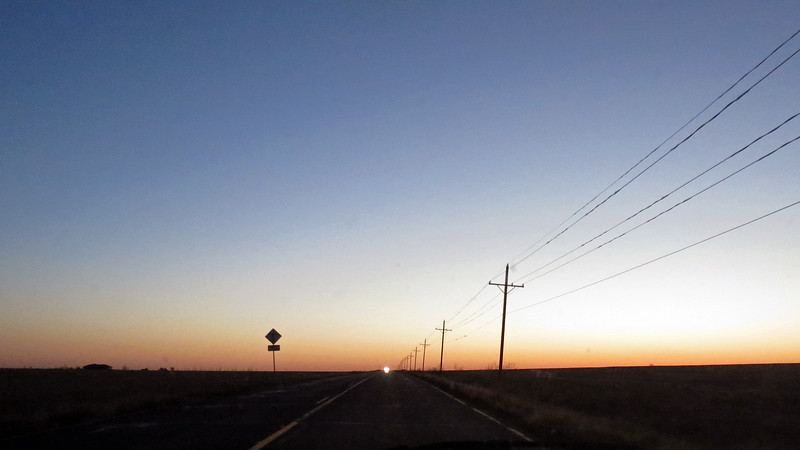 That may look like the rising sun on the horizon in the photo above.  But it was actually the headlights of one of the few oncoming cars I encountered on this road.