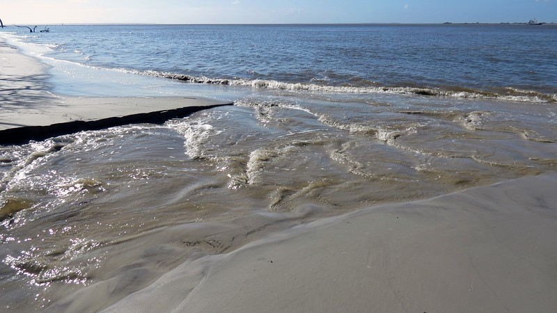 I walked south along the beach area and came to a spot where water was flowing from the island.