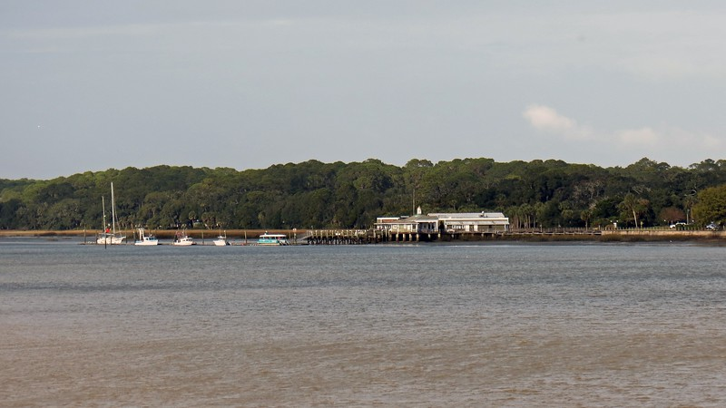 The Jekyll Island Club Wharf and Marina is visible in the distance.