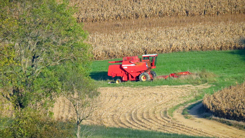 The Combine seen in the photos above and below belongs to a neighbor across the street.  But given the size of the properties around here, that distance is actually more than 1/4 mile.  I love my 35x optical zoom !