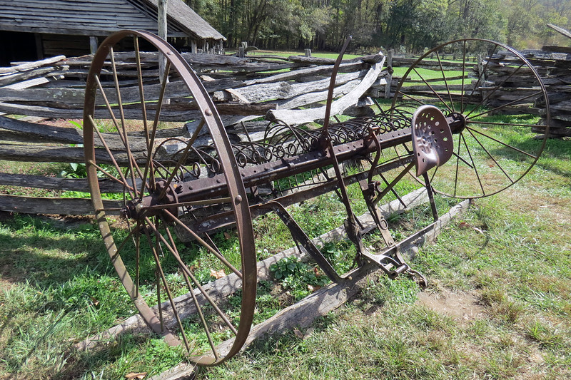 Period correct farm equipment outside of the Enloe Barn.
