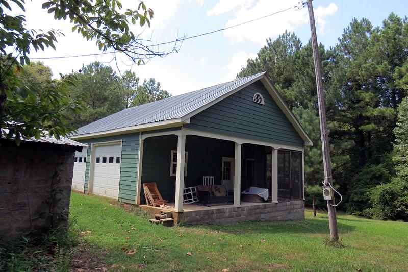 A modern garage was added at some point.