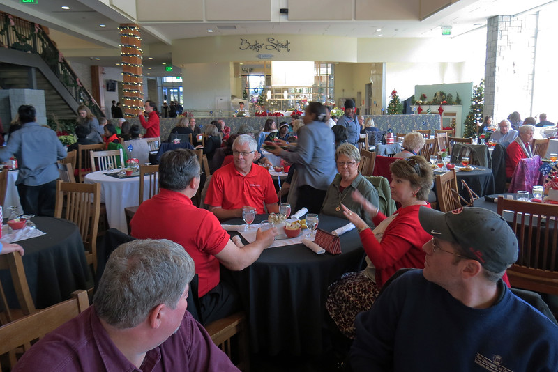 "This year, we were seated at 4 smaller tables in the middle of the General Seating area, a decision that was met with mixed reviews.  The feeling of ""community"" can be difficult to achieve with the tables spread out in a line.  Brent wasn't able to welcome the entire group like he has done in the past.  But conversation at the individual tables seemed to be much easier.  Maneuverability was enhanced as well in that it was easier for everyone to get to/from the buffet."