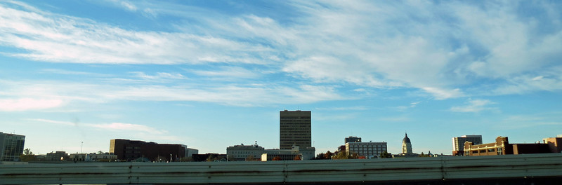Downtown Topeka, Kansas.  The dome of the State Capital Building can be seen on the right side of the photo above.