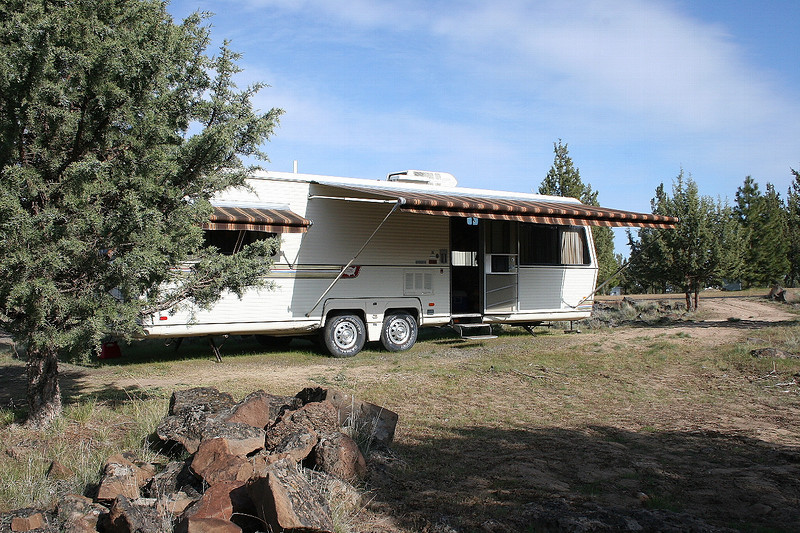 I picked up this 32' Holiday Rambler Imperial for $2500.  A/C and four ZipDee awnings.  Fridge didn't work, but I found an exact match in working condition for $25.  It's a work in progress.