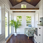 White walls, contrasting dark wood ceiling and floor