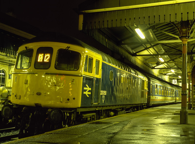 33050 at Salisbury, with the 17:25 Salisbury - Waterloo, on 30th December 1987. <br /> Scanned Transparency.