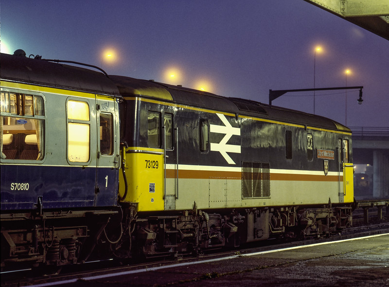 """73129 """"City of Winchester"""" in the Middle Sidings at Bournemouth, waiting to run in to form the front half of the 19:46 Weymouth - Waterloo, on 16th April 1988. Scanned Transparency."""