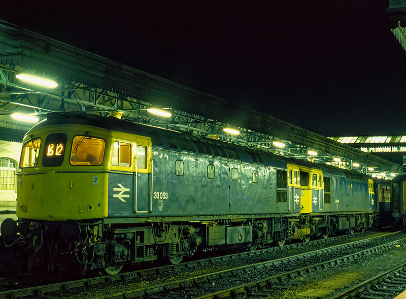33053 and 33004 at Exeter St Davids with the 18:17 service to Waterloo, <br /> on 28th December 1984.