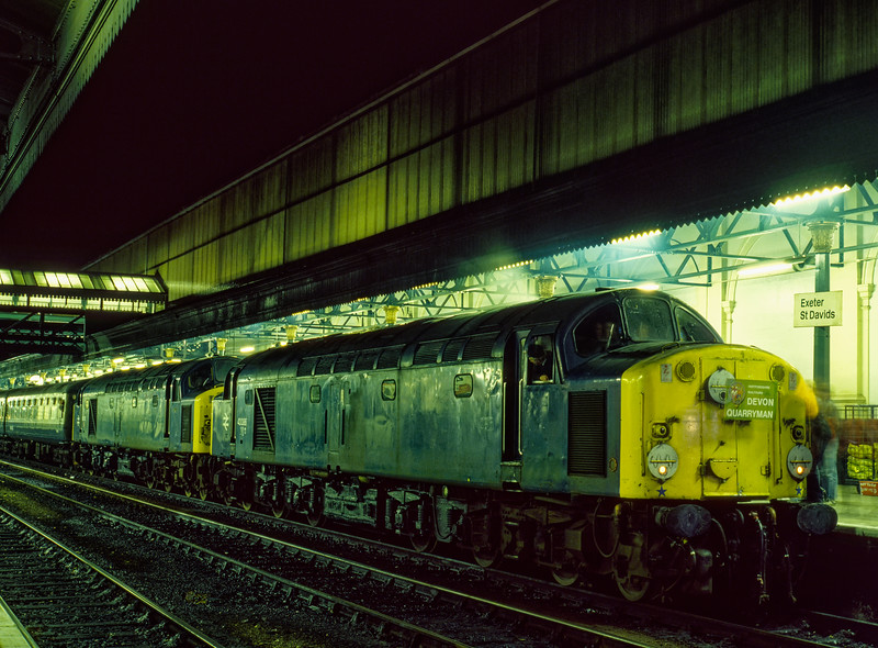 """40086 and 40118 at Exeter St Davids with 1Z26, the """"Devon Quarryman"""" railtour, ran by Hertfordshire Railtours on 24th November 1984. The train had just returned from Meldon Quarry, after reversal at Exeter, it retraced its outward route to Birmingham New Street. From there, 81009 took the train back to Euston."""