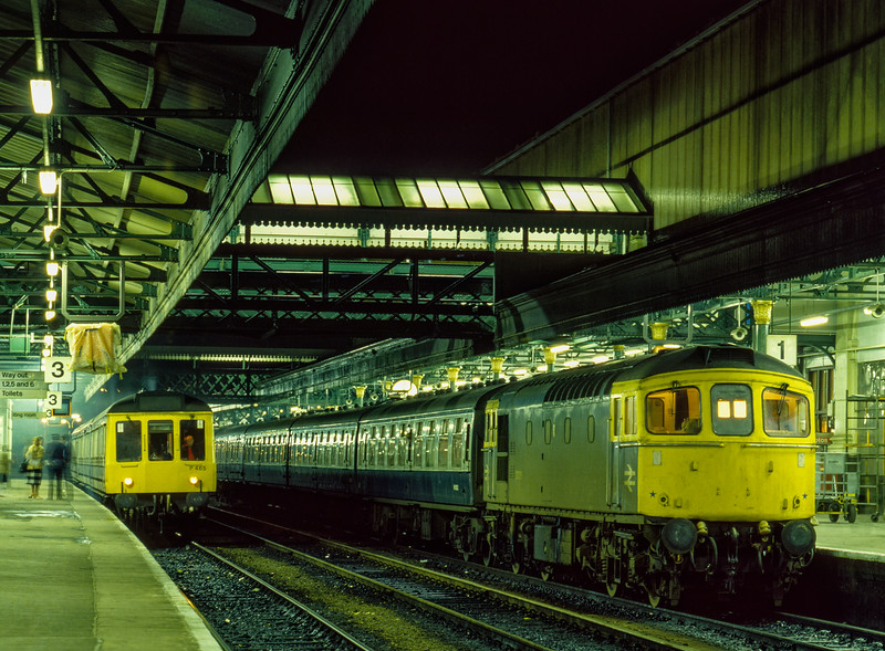 33031 at Exeter St Davids with the 16:07 Barnstaple - Paignton, on 24th November 1984. DMMU P465 waits in platform 3 with a local service.
