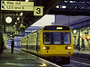 142027 at Exeter St Davids with the 18:18 service to Newton Abbot, on 3rd October 1987.