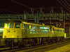 85037 and 81005 at Crewe, waiting for a path to the depot, on 30th December 1986.