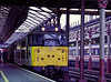 31200 at Crewe, with an unidentified southbound vans working, on 11th September 1989.