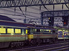 87021 at Crewe, with the 14:00 Euston - Glasgow, on 6th January 1988.