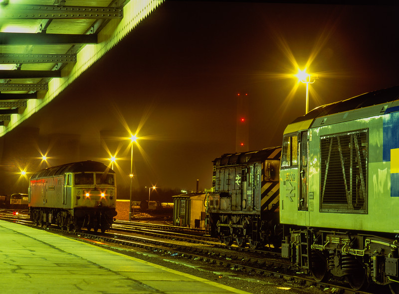 60009, 08850 and 47222 on the Loco Holding Sidings at Didcot on 23rd February 1991. 56060 is in the yard in the background