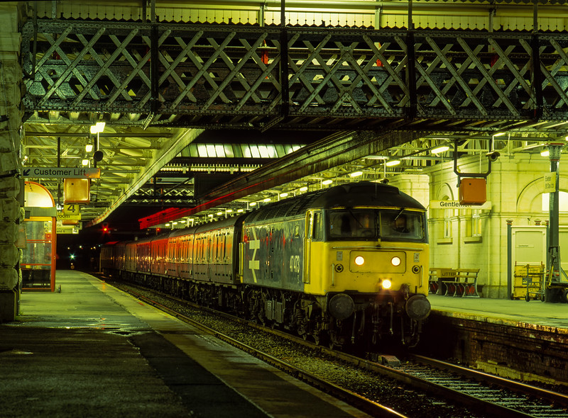 47473 at Exeter St Davids with 1E03, the 13:45 Penzance - Leeds Parcels, <br /> on 4th January 1991.