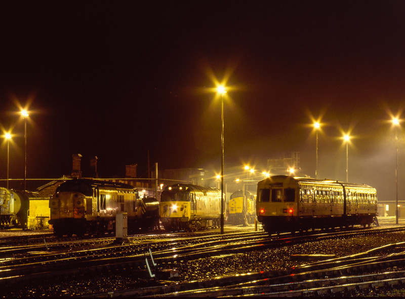 37098, 50033, DMMU 874 and one unidentified class 37 on Exeter Depot, <br /> on 21st March 1992.