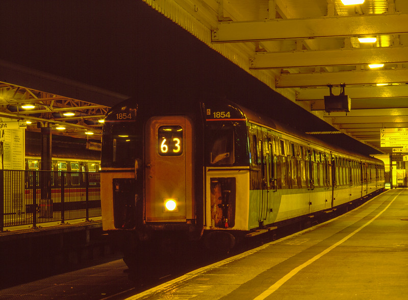 4-CIG 1854 at Portsmouth Harbour, with the 18:36 service to Brighton, <br /> on 18th February 2003.