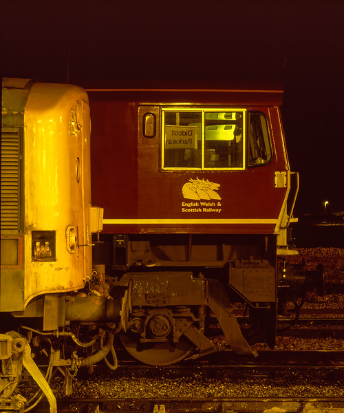 Cabside of 66229 on the Loco Holding Sidings at Didcot on 30th November 2004. <br /> Didcot station sign reflected in the cab window.