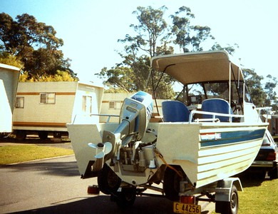 Caption by Mum. 'Michael's boat parked near our caravan, Lane Cove Sydney 1987. Came to pick us up for a day out on the Bay'.