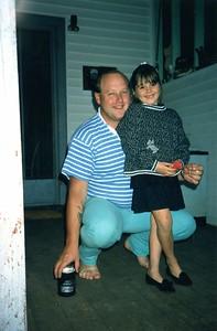 Karleigh and Bob playing darts at Mum and Reg's place Borung.