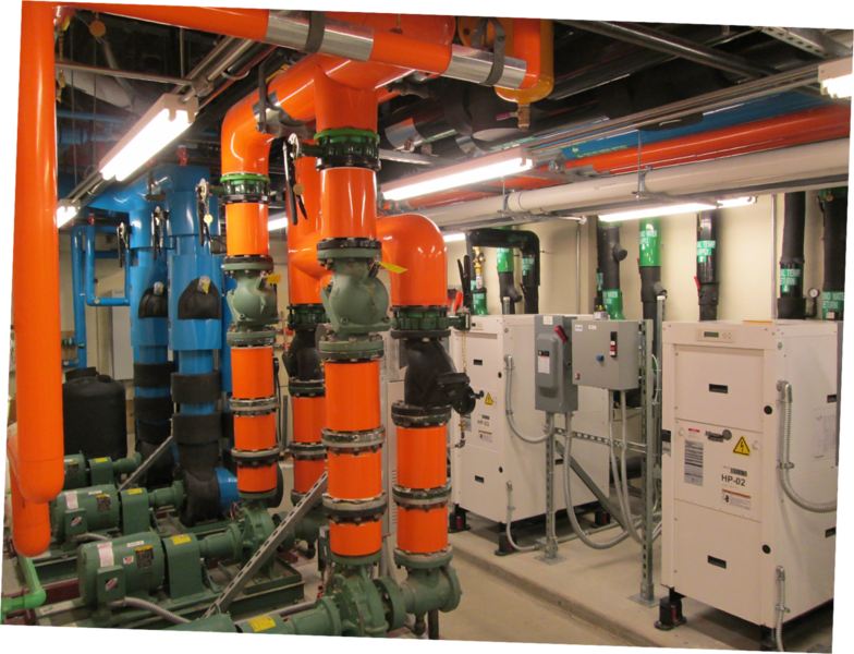 Expanded mechanical room – color coded to differentiate the building systems from the geothermal systems – first building on campus with Geothermal heating and cooling system. 19 wells, each over 500 feet deep – circulate non-hazardous fluid down into the wells and back to the heat pumps (white boxes shown).  Means we don't need conventional oil or gas boilers or electric air conditioners.