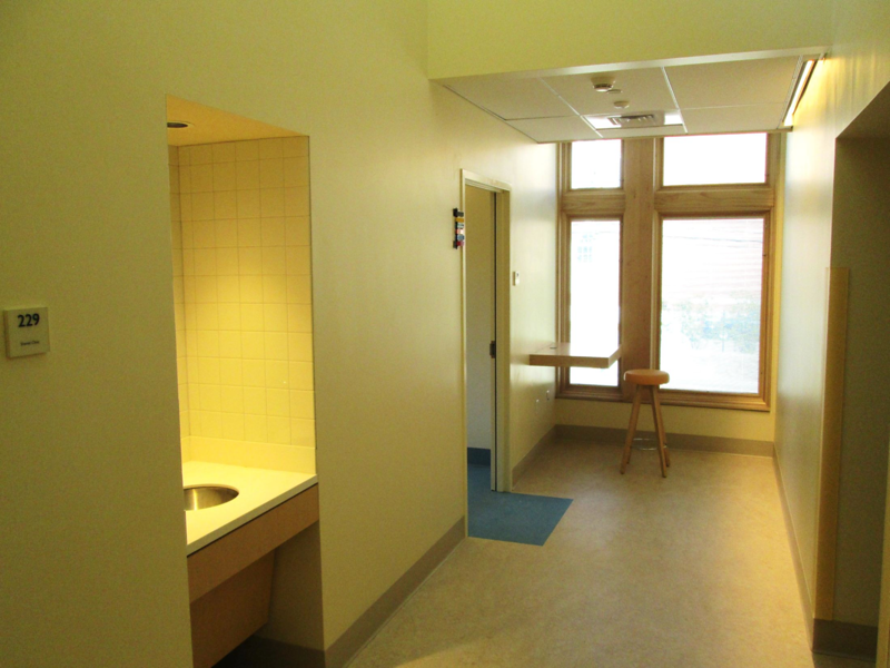 North wing hallway – this is the outpatient wing – holds 6 exam rooms, 2 shared clinic rooms, X-Ray, lab, and pharmacy.