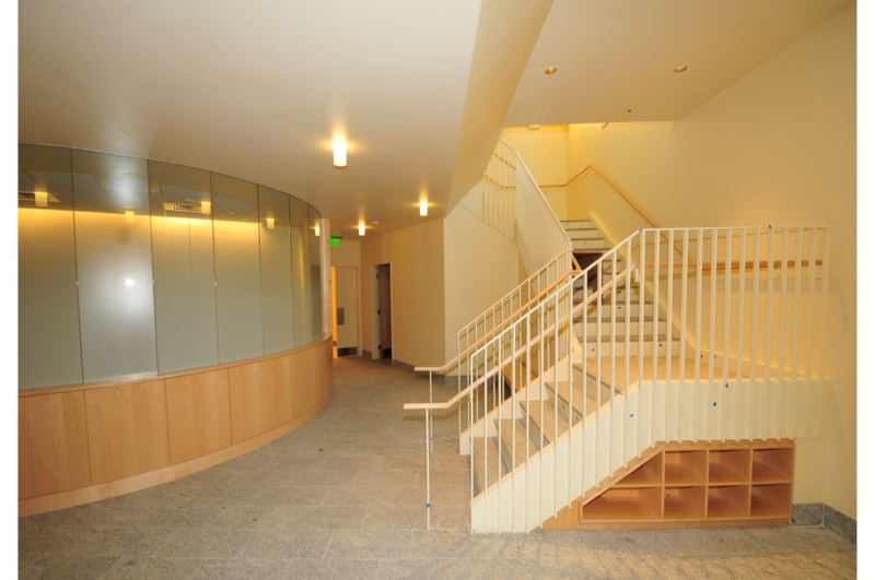 Center stair – lower level – conference room behind curved glass wall.