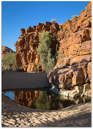 Waterhole and cliffs