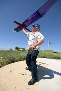 heger.xxxx.kitehill.jpg KITE HILL Tom Burgess of Laguna Beach, California, flies his model glider from the summit of Kite Hill in Laguna Niguel on Tuesday , May 23rd 2006.  Kite Hill has long been a spot for model plane and glider afficionados because of its location and typically strong winds.