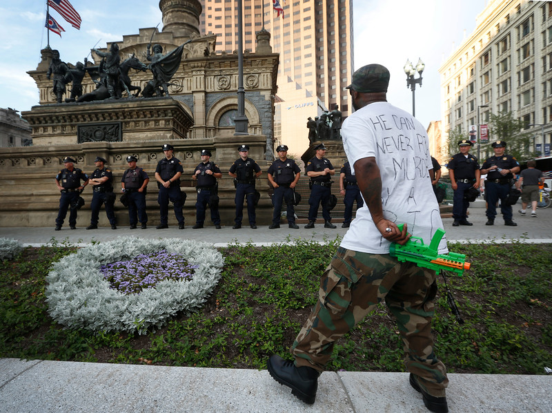 Stevedore Crawford Jr, a protester against the shooting of 12-year-old Tamir Rice in Cleveland, Ohio in 2014, stands in front of police officers on the first day of the Republican National Convention in Cleveland, Ohio on July 19, 2016.