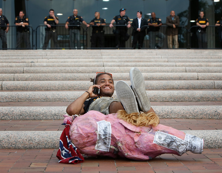 A protester lies on the ground in front of a line of police guarding a building in Cleveland, Ohio during the Republican National Convention on July 21, 2016.