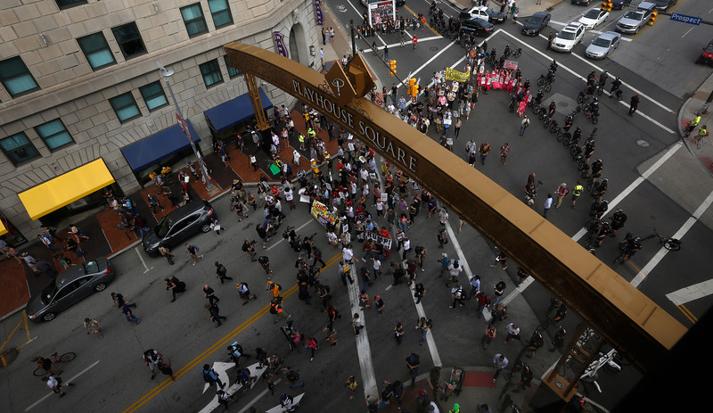Protesters march through the streets of downtown Cleveland, Ohio ahead of the Republican National Convention on July 17, 2016.