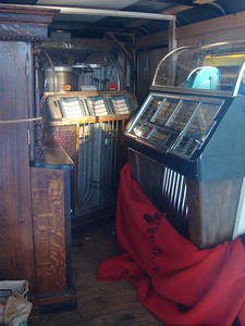 A couple three jukeboxes