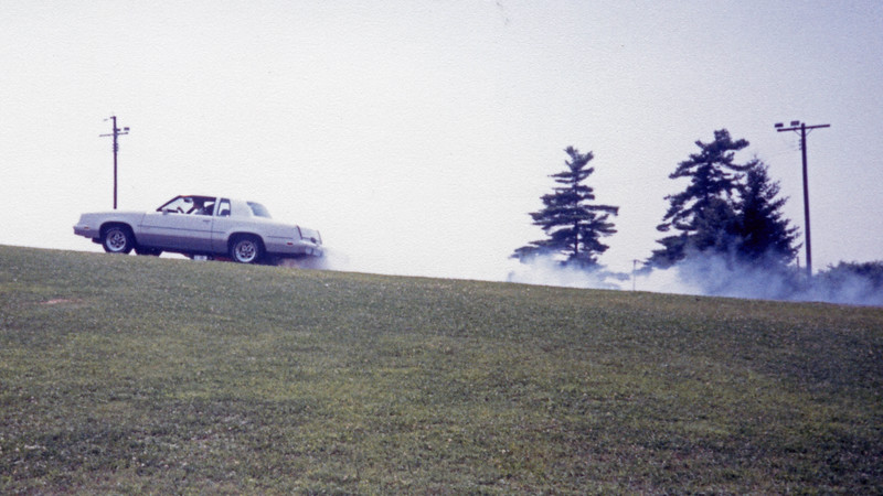For whatever bizarre reason, GM did not equip the 442 with a limited slip rear differential.  The car's 3.73 rear axle ratio would allow for a smokey burnout, but only from one tire.  My opponent for this pass was a 1968 Olds 442.  I ran 16.61 seconds.