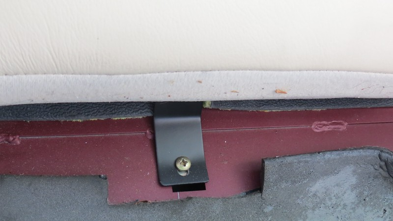 The rear seat backrest is also held in place by two Philips head screws.