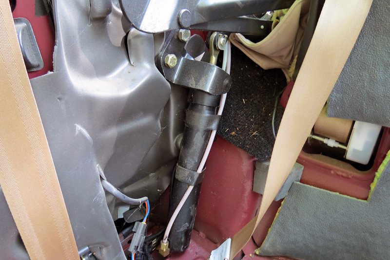 Replacing the cylinders was a surprisingly simple repair.  The first step was to remove the top mounting bracket.