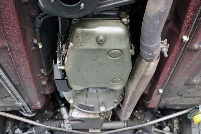 I believe this is a ZF 4HP24 4-speed automatic transmission.  Some sources I have examined indicated that these cars sourced a GM 4L80E 4-speed unit.  But I think it was only used in the V-12 cars.  Six-cylinder cars, like mine, appear to have received the ZF box.